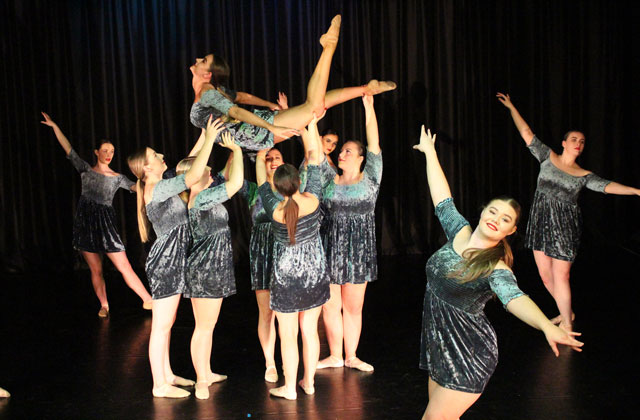 Performing Arts students dancing in green dresses